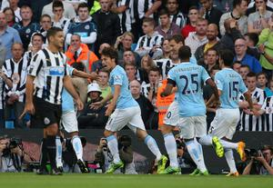 MANCHESTER, ENGLAND - AUGUST 19:  David Silva of Manchester City runs away to celebrate after scoring the first goal past Tim Krul of Newcastle United during the Barclays Premier League match between Manchester City and Newcastle United at the Etihad Stadium on August 19, 2013 in Manchester, England.  (Photo by Clive Brunskill/Getty Images)