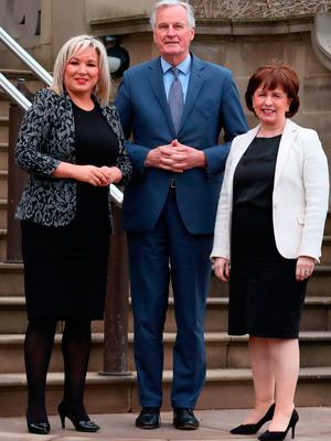 Deputy First Minister Michelle O'Neill and Economy Minister Diane Dodds with the European Commission's Michel Barnier at Stormont yesterday