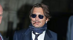 Johnny Depp is suing the Sun's publisher, News Group Newspapers, and its executive editor, Dan Wootton, over an April 2018 article which referred to the actor as a 'wife beater' (Yui Mok/PA)