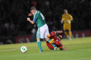 Pacemaker Press 6/9/2013 Northern Ireland v Portugal World Cup Qualifier Northern Ireland's  Steve Davis   and Portugal's  Vieirinha during this evening's game at Windsor Park in Belfast Pic Colm Lenaghan/Pacemaker
