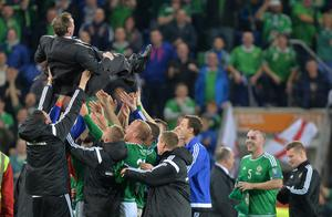 Northern Ireland Manager  celebrates with his players after Thursday evening's game at Windsor park in Belfast. Photo Colm Lenaghan/Pacemaker Press