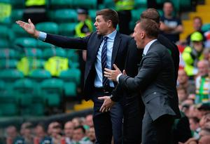 Renewing battle: Gers boss Steven Gerrard with Celtic chief Brendan Rodgers during the Bhoys' 1-0 win at Parkhead earlier this season