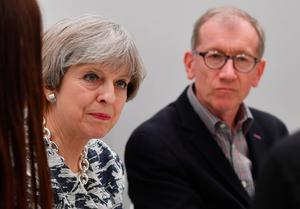 NOTTINGHAM, UNITED KINGDOM - JUNE 07:  Britain's Prime Minister and leader of the Conservative Party Theresa May and husband Philip speak to staff at a Dunelm department store during a campaign visit on June 7, 2017 in Nottingham, England.  Britain goes to the polls tomorrow June 8 to vote in a general election.  (Photo by Ben Stansall - WPA Pool/Getty Images)