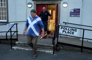 Voters leave Gretna polling station after voting on September 18, 2014 in Gretna, Scotland. After many months of campaigning the people of Scotland today head to the polls to decide the fate of their country.  The referendum is too close to call but a 'Yes' vote would see the break-up of the United Kingdom and Scotland would stand as an independent country for the first time since the formation of the Union.  (Photo by Christopher Furlong/Getty Images)