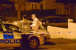PSNI officers and forensic officers investigate. Police have said that the roads will remain closed for the next few hours. Photo: Kirth Ferris/Pacemaker Press
