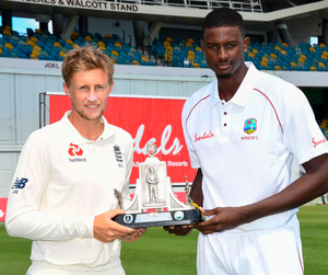 Up for grabs: Joe Root and Jason Holder with the Wisden trophy