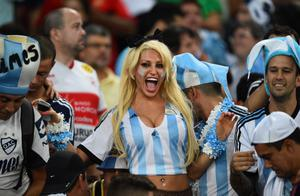 The beautiful game - football fans from around the world -  Argentina fans cheer prior to the 2014 FIFA World Cup Brazil Group F match between Argentina and Bosnia-Herzegovina at Maracana on June 15, 2014 in Rio de Janeiro, Brazil.  (Photo by Matthias Hangst/Getty Images)