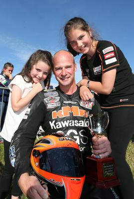 Champion: Ryan Farquhar celebrates winning the Supertwins race at the Armoy road races with his daughters May and Keeley.