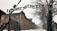 The entrance gates to Auschwitz in Poland. Photo: Jemma Crew/PA Wire