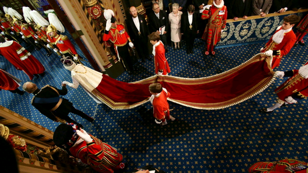 Queen Elizabeth II and the Prince Philip, Duke of Edinburgh proceed through the Royal Gallery