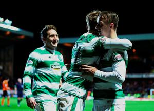 DUNDEE, SCOTLAND - JANUARY 15   Leigh Griffiths (R), of Celtic is congratulated after scoring his second goal in the second half during the Ladbrokes Scottish Premiership match between Celtic FC and Dundee United FC at Tannadice Park on January 15, 2016 in Dundee, Scotland. (Photo by Mark Runnacles/Getty Images)