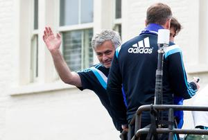 Chelsea's Portuguese manager Jose Mourinho (C) waves to supporters as the Chelsea team leave Stamford Bridge stadium in an open-top bus parade to celebrate winning the premier league in west London on May 25, 2015.  AFP PHOTO / JUSTIN TALLISJUSTIN TALLIS/AFP/Getty Images