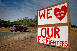 CLEARLAKE OAKES, CA - AUGUST 04:  A sign thanking firefighters who are battling the Rocky Fire is posted in front of the Moose Lodge on August 4, 2015 in Clearlake Oakes, California. Nearly 3,000 firefighters are battling the Rocky Fire that has burned  65,000 acres and forced the evacuation of 12,000 residents in Lake County. The fire is currently 12 percent contained and has destroyed at least 14 homes. 6,300 homes are threatened by the fast moving blaze.  (Photo by Justin Sullivan/Getty Images)