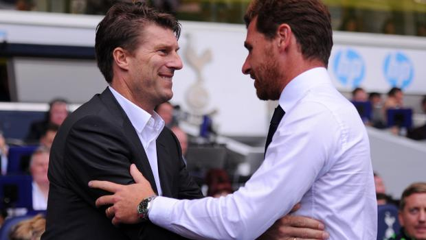 LONDON, ENGLAND - AUGUST 25:  (L-R) Michael Laudrup the Swansea manager is greeted by Andre Villas-Boas the Spurs manager prior to kick off during the Barclays Premier League match between Tottenham Hotspur and Swansea City at White Hart Lane on August 25, 2013 in London, England.  (Photo by Michael Regan/Getty Images)