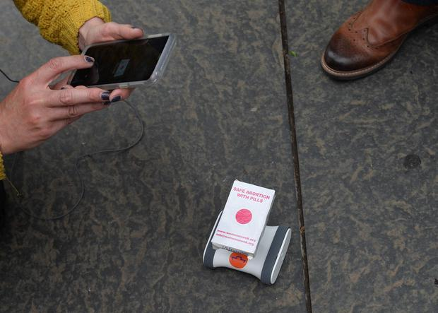 Pacemaker Press  31/5/2018   Pro Choice campaigners take a pill during a  protest  outside  the Belfast Courts on Thursday.   Abortion pills where  delivered by robots to activists waiting to take them, The protest took place in answer to the ongoing abortion ban in Northern Ireland. Pic Pacemaker
