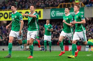 Northern Ireland's Jonny Evans (second left) celebrates scoring his side's first goal of the game with team-mates during the UEFA Euro 2020 Qualifying, Group C match at Windsor Park, Belfast. PRESS ASSOCIATION Photo. Picture date: Sunday March 24, 2019. See PA story SOCCER N Ireland. Photo credit should read: Brian Lawless/PA Wire. RESTRICTIONS: Use subject to restrictions. Editorial use only. No commercial use.