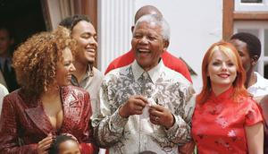 File photo dated 31/05/1998 of South Africa's President, Nelson Mandela, flanked by Spice Girls Mel B (left) and Geri Halliwell (right) during  a photocall with the Spice Girls at the presidential residence Mahlamba Nalopfu in Pretoria, South Africa. Former South African leader Nelson Mandela has died at the age of 95, the country's president, Jacob Zuma, said tonight. PRESS ASSOCIATION Photo. Issue date: Thursday December 5, 2013. See PA story DEATH Mandela. Photo credit should read John Stillwell/PA Wire