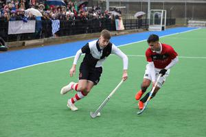 Wallace High School's Caeron Forrest, left, in action against Friends School's Conor Quinn during the Burney Cup Hockey Semi-Final.  Photo by Peter Morrison