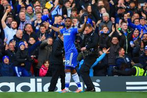 LONDON, ENGLAND - MARCH 22:  Samuel Eto'o of Chelsea celebrates scoring the opening goal uring the Barclays Premier League match between Chelsea and Arsenal at Stamford Bridge on March 22, 2014 in London, England.  (Photo by Richard Heathcote/Getty Images)