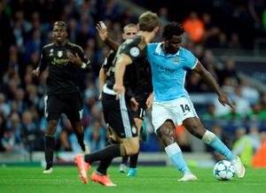Manchester City's Ivorian striker Wilfried Bony (R) has a shot on goal during a UEFA Champions League group stage football match between Manchester City and Juventus at the Etihad stadium in Manchester, north-west England on September 15, 2015.       AFP PHOTO / OLI SCARFFOLI SCARFF/AFP/Getty Images