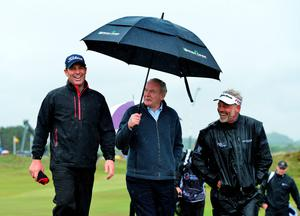 NEWCASTLE, NORTHERN IRELAND - MAY 27 : Deputy First Minister Martin McGuinness (C), former Australian cricketer Shane Warne (L), and Darren Clarke of Northern Ireland walk from the 18th green after playing in the Pro-Am during the Irish Open Previews at Royal County Down Golf Club on May 27, 2015 in Newcastle, United Kingdom. (Photo by Mark Runnacles/Getty Images)