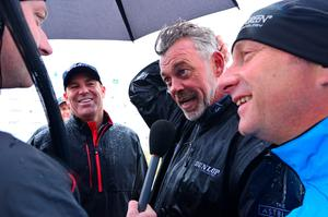 NEWCASTLE, NORTHERN IRELAND - MAY 27 Darren Clarke of Northern Ireland (C), Stephen Watson of BBC Northern Ireland (R) and former Australian cricketer Shane share a joke after playing in the Pro-Am during the Irish Open Previews at Royal County Down Golf Club on May 27, 2015 in Newcastle, United Kingdom. (Photo by Mark Runnacles/Getty Images)