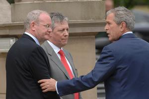 File photo dated 16/06/8 of Sinn Fein Deputy First Minister Martin McGuinness (left) and First Minister Peter Robinson (centre) with US President George Bush at Stormont Castle in Belfast.  PA Wire