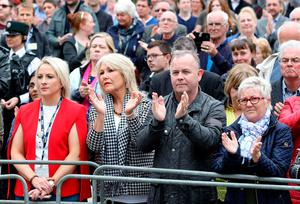 Mourners gesture as pallbearers carry the coffin of journalist Lyra McKee (29), who was killed by a dissident republican paramilitary in Northern Ireland on April 18, during the funeral service at St Anne's Cathedral in Belfast on April 24, 2019. - Lyra McKee, 29, who chronicled the troubled history of Northern Ireland, was shot in the head on April 18, 2019, as rioters clashed with police in Londonderry, the second city of the British province. (Photo by Paul Faith / AFP)PAUL FAITH/AFP/Getty Images