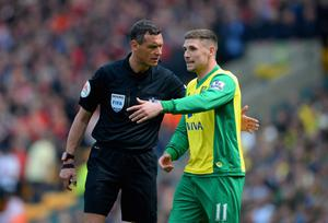 NORWICH, ENGLAND - APRIL 20:  Referee Andre Marriner speaks ot Gary Hooper of Norwich City during the Barclays Premier League match between Norwich City and Liverpool at Carrow Road on April 20, 2014 in Norwich, England.  (Photo by Michael Regan/Getty Images)