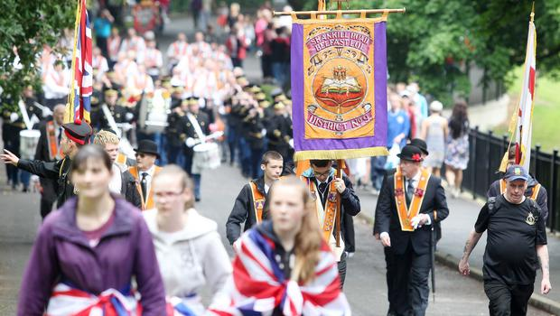 Press Eye - Belfast -  Northern Ireland - 13th July  2015  Belfast's Orange Order annual 12th of July demonstration makes its way through the City Centre to the field at Malone House beside Shaws Bridge.  The parade makes its way into the field.   Picture by Jonathan Porter/Press Eye