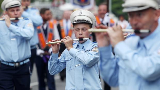 Press Eye - Belfast -  Northern Ireland - 13th July  2015  Belfast's Orange Order annual 12th of July demonstration makes its way through the City Centre to the field at Malone House beside Shaws Bridge.  The parade makes its way up Malone Road.   Picture by Jonathan Porter/Press Eye