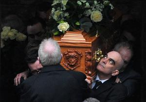 Alan Lewis - PhotopressBelfast.co.uk         15/2/2015 Mandatory Credit - Picture by Justin Kernoghan Oisin McGrath's father Nigel helping to carry Oisin's coffin from St Patrick's Church in Belcoo.  The funeral of Belcoo schoolboy Oisin McGrath has taken place in County Fermanagh. Oisin who was 13, died in hospital on Thursday after being injured in an incident at St Michael's College, Enniskillen, on Monday afternoon. Oisin had been on a life-support machine since the incident. A 17-year-old boy, a sixth former at the school, was detained following the incident. He was later released on bail pending further inquiries. The funeral took place at St Patrick's Church in Holywell. Hundreds of schoolchildren lined the route of the funeral. Some of them wore GAA jerseys in tribute to the 13-year-old, who played Gaelic football in Belcoo.Oisin's organs are to be used to help five other people, his parish priest Fr Seamus Quinn said.