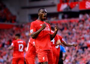 "Liverpool's Christian Benteke celebrates scoring his side's first goal of the game during the Barclays Premier League match at Anfield, Liverpool. PRESS ASSOCIATION Photo. Picture date: Monday August 17, 2015. See PA story SOCCER Liverpool. Photo credit should read: Peter Byrne/PA Wire. EDITORIAL USE ONLY. No use with unauthorised audio, video, data, fixture lists, club/league logos or ""live"" services. Online in-match use limited to 45 images, no video emulation. No use in betting, games or single club/league/player publications."