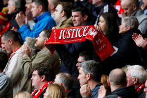 Members of the crowd during the last memorial service to be held at Anfield, Liverpool, to mark 27 years to the day since the tragedy claimed 96 lives. PA