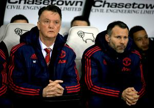 Manchester United manager Louis van Gaal (left) and assistant manager Ryan Giggs in the dugout before the Emirates FA Cup, fourth round match at the iPro Stadium, Derby.