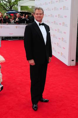 Hugh Bonneville arriving for the 2013 Arqiva British Academy Television Awards at the Royal Festival Hall, London. PRESS ASSOCIATION Photo. Picture date: Sunday May 12, 2013. See PA story SHOWBIZ Bafta. Photo credit should read: Ian West/PA Wire