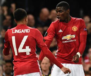Manchester United's French midfielder Paul Pogba (R) and Manchester United's English midfielder Jesse Lingard (L) do a celebration dance after Pogba scored their third goal during the UEFA Europa League group A football match between Manchester United and Fenerbahce at Old Trafford in Manchester, north west England, on October 20, 2016. AFP/Getty Images