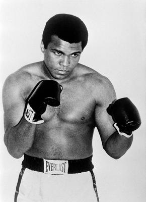"""This file photo taken on January 01, 1965 U.S. boxing champion Cassius Clay alia Muhammad Ali in Paris.  Boxing icon Muhammad Ali died on Friday, June 3, a family spokesman said in a statement. """"After a 32-year battle with Parkinsons disease, Muhammad Ali has passed away at the age of 74,"""" spokesman Bob Gunnell said. / AFP PHOTO / PIGISTEPIGISTE/AFP/Getty Images"""