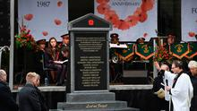 Disputed symbol: the Enniskillen Poppy Day memorial unveiling in Enniskillen town centre to mark the 30th anniversary of the bombing