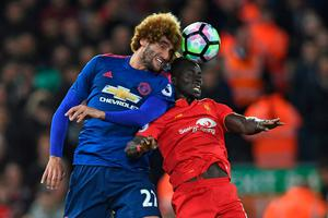 Manchester United's Belgian midfielder Marouane Fellaini (L) vies with Liverpool's Senegalese midfielder Sadio Mane during the English Premier League football match between Liverpool and Manchester United at Anfield in Liverpool, north west England on October 17, 2016. AFP/Getty Images