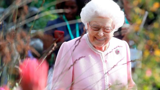 TOPSHOT - Britain's Queen Elizabeth II visits the 2018 Chelsea Flower Show in London on May 21, 2018. The Chelsea flower show, held annually in the grounds of the Royal Hospital Chelsea, opens to the public on May 22.  / AFP PHOTO / POOL / Chris JacksonCHRIS JACKSON/AFP/Getty Images