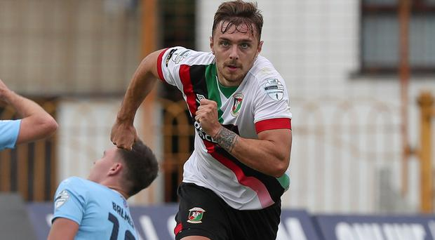 Robbie McDaid celebrates his winner in Ballymena.