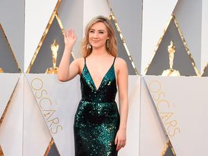 Actress Saoirse Ronan arrives on the red carpet for the 88th Oscars on February 28, 2016 in Hollywood, California. AFP PHOTO / VALERIE MACONVALERIE MACON/AFP/Getty Images