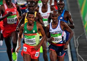Ethiopia's Hagos Gebrhiwet (L) and Britain's Mo Farah compete in the Men's 5000m Final during the athletics event at the Rio 2016 Olympic Games at the Olympic Stadium in Rio de Janeiro on August 20, 2016.   / AFP PHOTO / PEDRO UGARTEPEDRO UGARTE/AFP/Getty Images