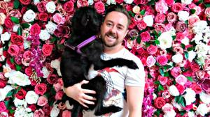 Budding company: Mark Byrne with one of his flower walls