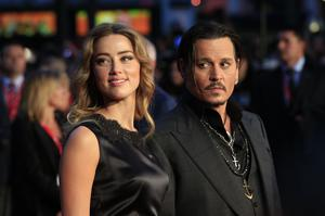 Amber Heard and Johnny Depp attending the premiere of Black Mass during the 59th BFI London Film Festival in 2015 (Jonathan Brady/PA)