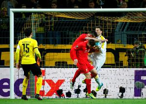 Liverpool's Croatian defender Dejan Lovren (C) clashes with Dortmund's goalkeeper Roman Weidenfeller during the UEFA Europe League quarter-final, first-leg football match Borussia Dortmund vs Liverpool FC in Dortmund, western Germany on April 7, 2016. / AFP PHOTO / ODD ANDERSENODD ANDERSEN/AFP/Getty Images
