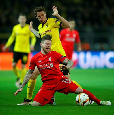 DORTMUND, GERMANY - APRIL 07:  Alberto Moreno of Liverpool is challenged by Eric Durm of Borussia Dortmund during the UEFA Europa League quarter final first leg match between Borussia Dortmund and Liverpool at Signal Iduna Park on April 7, 2016 in Dortmund, Germany.  (Photo by Lars Baron/Bongarts/Getty Images)