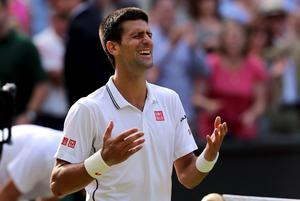 Serbia's Novak Djokovic celebrates beating Switzerland's Roger Federer in the Mens singles final during day fourteen of the Wimbledon Championships at the All England Lawn Tennis and Croquet Club, Wimbledon.
