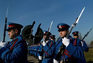 A Serbian military honor guard pay homage to the victims of the Holocaust at a monument in World War II Nazi concentration camp Sajmiste, in Belgrade, Serbia, Wednesday, Jan. 27, 2016. International Holocaust remembrance day marks the liberation of the Nazi concentration camp Auschwitz on Jan. 27, 1945. (AP Photo/Darko Vojinovic)